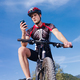 Young Man with Telephone Riding Mountain Bike - PhotoDune Item for Sale