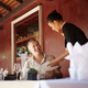 Asian Waitress Talking with Client in Restaurant - PhotoDune Item for Sale