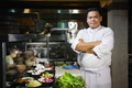 Asian Chef Smiling at Camera in Restaurant Kitchen - PhotoDune Item for Sale