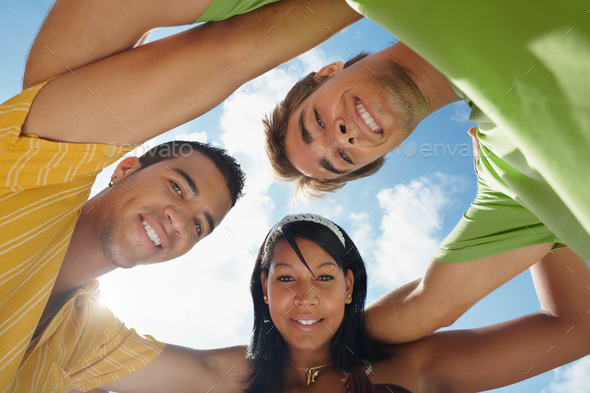 Team of Men and Woman Embracing and Smiling at Camera - Stock Photo - Images