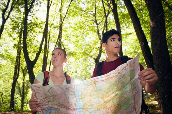 Young Couple Looking At Map During Trek - Stock Photo - Images