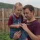 Girl with a Strange Toy Hugging Her Dad - VideoHive Item for Sale