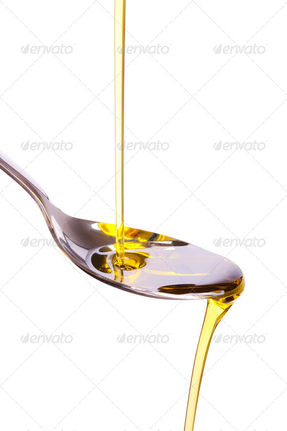 olive oil poured into spoon - Stock Photo - Images