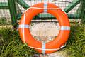 Marine lifebuoy on fence