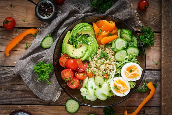 Bulgur porridge, egg and fresh vegetables - tomatoes, cucumber, celery and avocado - Stock Photo - Images