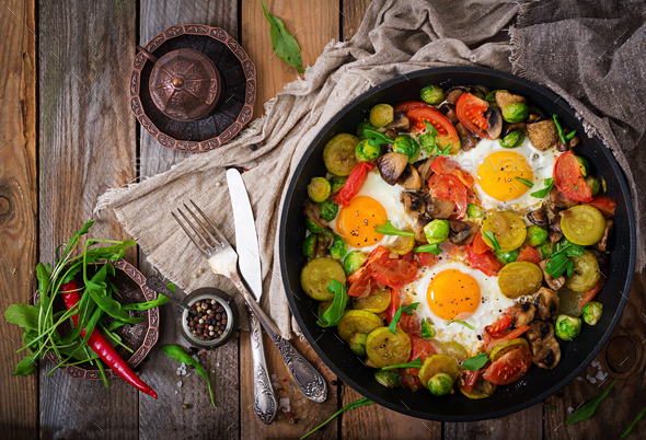 Breakfast for two. Fried eggs with vegetables - shakshuka - Stock Photo - Images