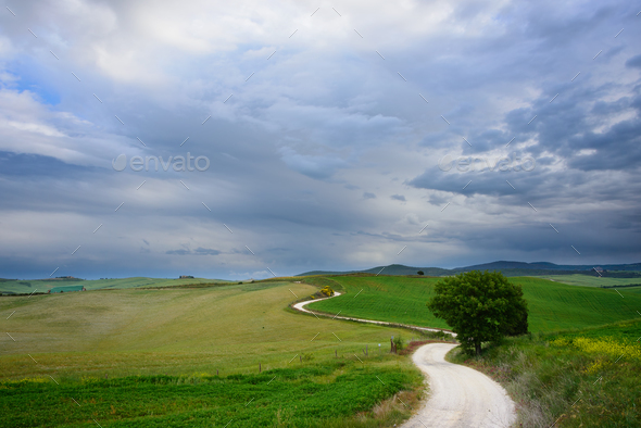 A winding road to an unknown destination - Stock Photo - Images