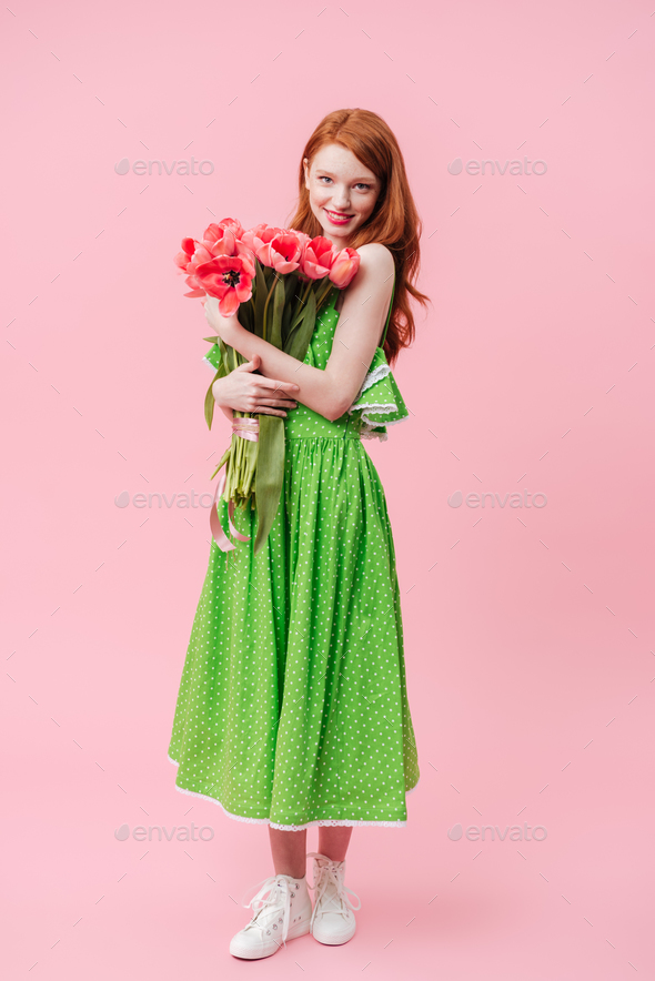 Full length image  ginger woman holding bouquet of flowers
