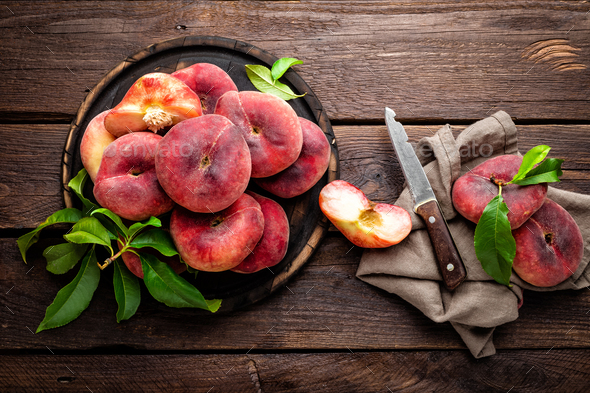 Peach, saturn or donut peaches with leaves - Stock Photo - Images