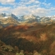 Golden Autumn Mountain Hills, Snow Tops and Red Forest. Cloud Shadows Show Relief - VideoHive Item for Sale