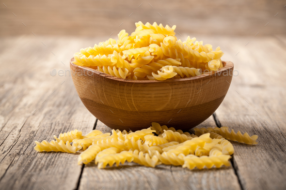Rotini pasta in wooden bowl - Stock Photo - Images