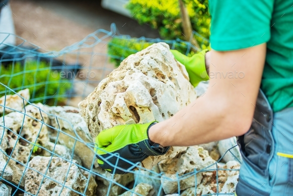 Choosing Garden Rocks - Stock Photo - Images