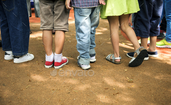Diverse kids standing together outdoors
