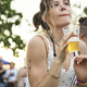 Woman with Beers Enjoying Music Festival - PhotoDune Item for Sale