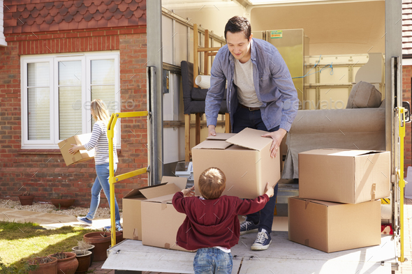 Family Unpacking Moving In Boxes From Removal Truck - Stock Photo - Images