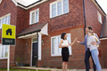 Young Couple Collecting Keys To New Home From Realtor - PhotoDune Item for Sale