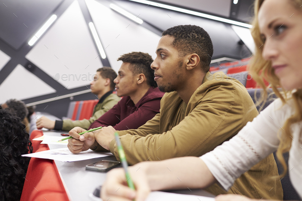 Students listening to lecture at university lecture theatre - Stock Photo - Images