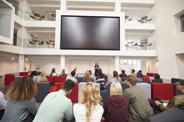 Back view of students at a lecture in a university atrium - Stock Photo - Images