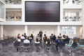 Mature Businessman Making Presentation At Conference