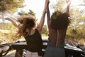 Two excited women stand in the back of open car, back view - PhotoDune Item for Sale