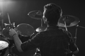 Black And White Shot Of Drummer Playing Drum Kit In Studio - PhotoDune Item for Sale