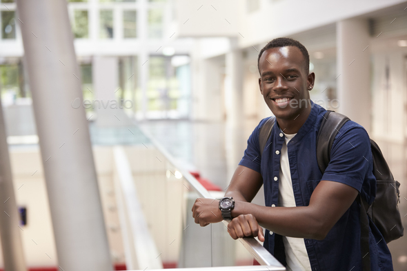 Smiling black male student in modern university, portrait - Stock Photo - Images