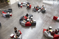 Students sit in groups in a modern university atrium - PhotoDune Item for Sale