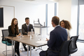 Businesspeople Working Together At Desk In Modern Office - PhotoDune Item for Sale