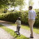 Rear View Of Father And Son Walking In Summer Countryside - PhotoDune Item for Sale
