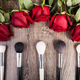 Conceptual image of make-up brushes next to roses - PhotoDune Item for Sale
