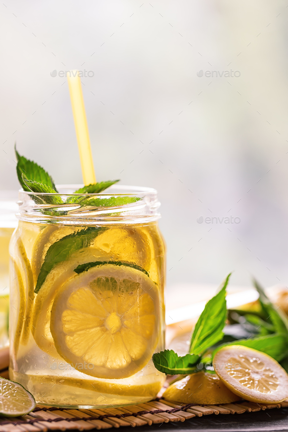 Bank lemonade with straw and mint leaves - Stock Photo - Images