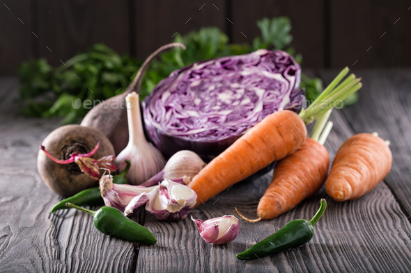 Vegetable still life on wooden table with wooden background - Stock Photo - Images