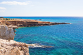 Rock cliffs and sea bay with azure water near Protaras, Cyprus island.