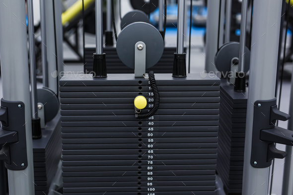 Black iron heavy plates stacked of weight machine in fitness gym. Sports simulator plates - Stock Photo - Images