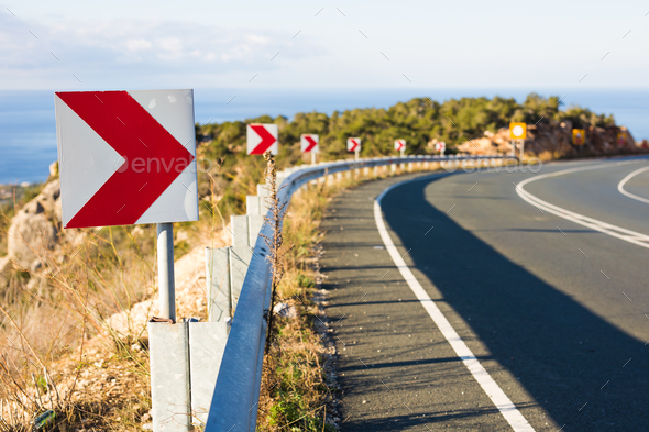 Right Turn Sign: Road signs warn of a sharp turn on a narrow road - Stock Photo - Images