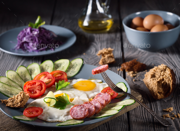 Scrambled eggs and sausage with vegetables - Stock Photo - Images
