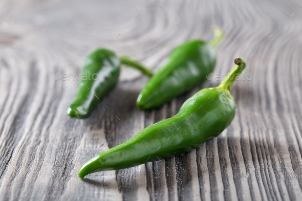 Green hot pepper on a wooden table - Stock Photo - Images