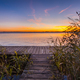 Sunset over Wooden Boardwalk on the shore of a Lake - PhotoDune Item for Sale