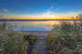 Long Exposure Image of Sunset over Boardwalk on the shore of a L