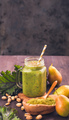 Jar of green smoothie with fresh kale