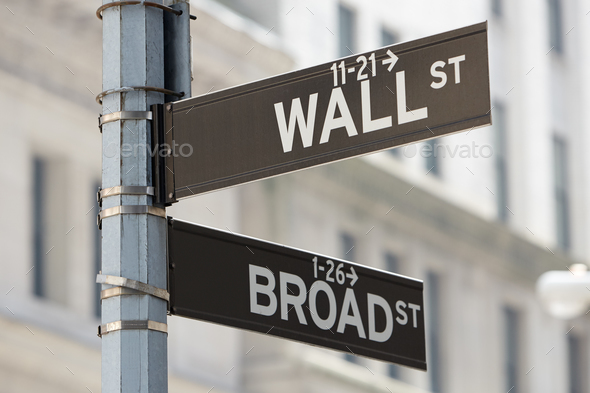Wall Street and Broad Street corner sign near Stock Exchange in New York