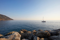 Mediterranean blue, calm sea and rocks with boat, clear sky - PhotoDune Item for Sale