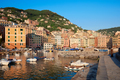 Camogli typical village with colorful houses and small harbor