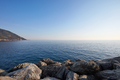 Mediterranean blue, calm sea with rocks and coast, clear sky - PhotoDune Item for Sale