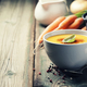 Vegetable cream soup in bowl over old wooden background - PhotoDune Item for Sale