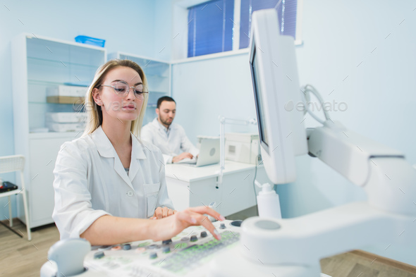 Young Scientists working at chemisty laboratory - Stock Photo - Images