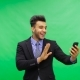 Cheerful Businessman Talking Online Use Cell Smart Phone Making Video Call Over Chroma Key Green - VideoHive Item for Sale