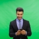 Smiling Businessman Use Cell Smart Phone Over Chroma Key Green Screen Happy Chatting Online - VideoHive Item for Sale