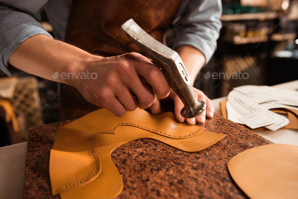 Close up of a shoemaker man working with leather - Stock Photo - Images
