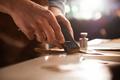 Shoemaker sharpening a knife